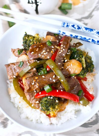 The combination of tender beef, fresh vegetables, and a rich garlic stir fry sauce