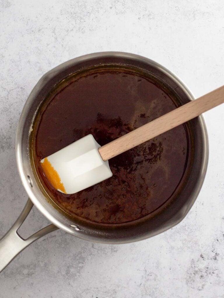 Caramelizing sugar inside of a saucepan.