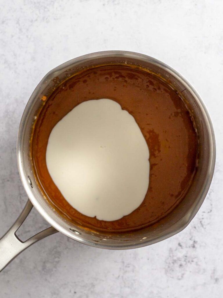 Cream added to caramelized sugar.