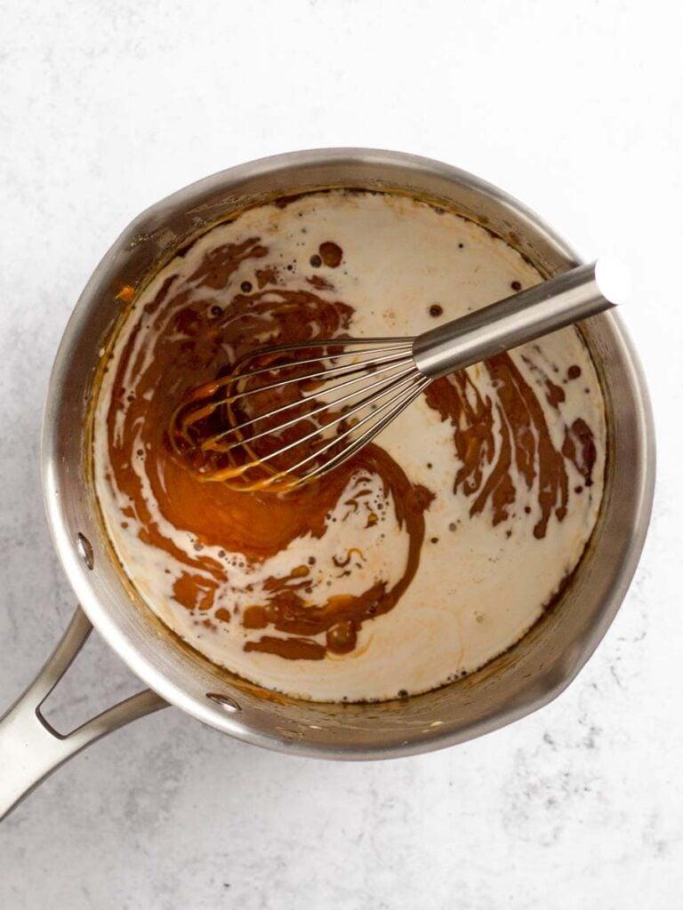 Whisking caramel sauce.