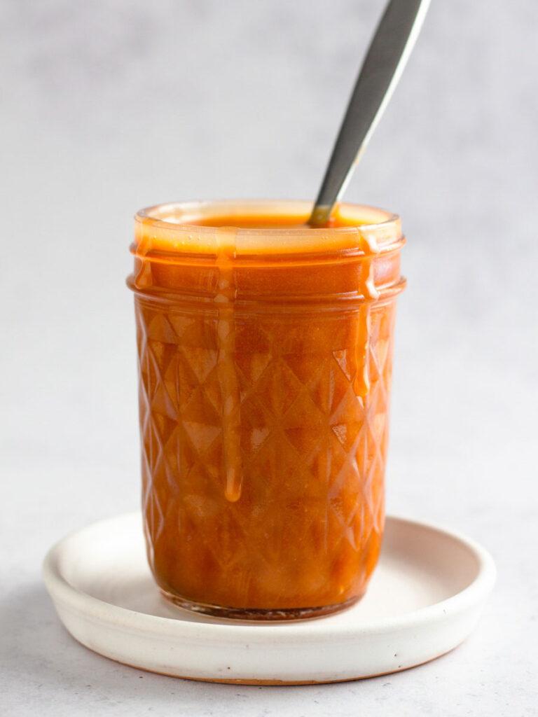 Caramel sauce in a mason jar.