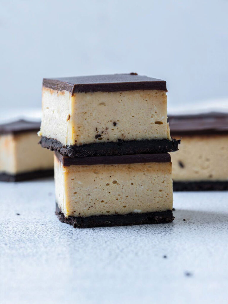 a stack of the cheesecake bars