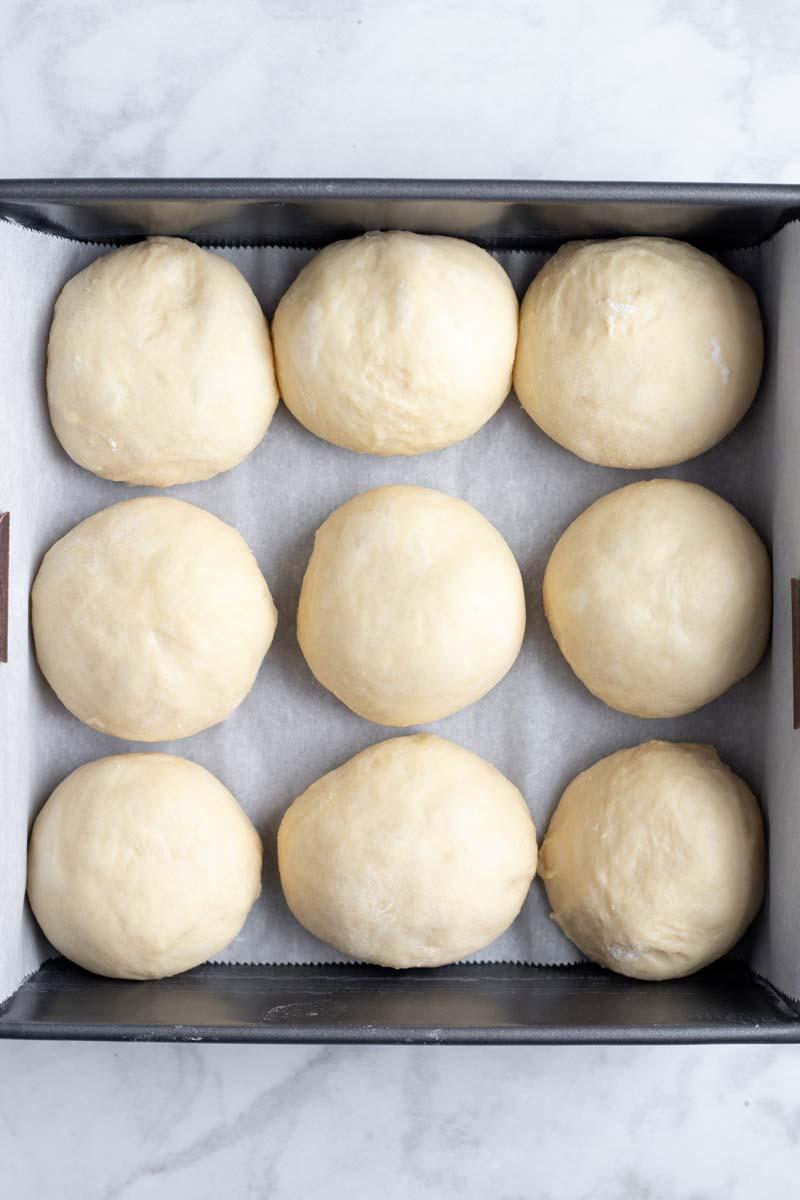 Hawaiian sweet rolls dough in a tray.