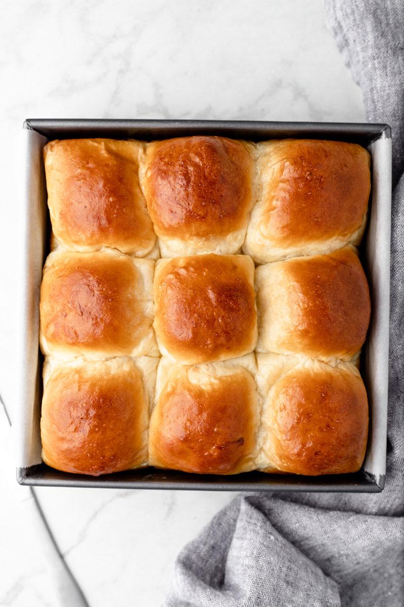 Baked sweet rolls inside of a tray.