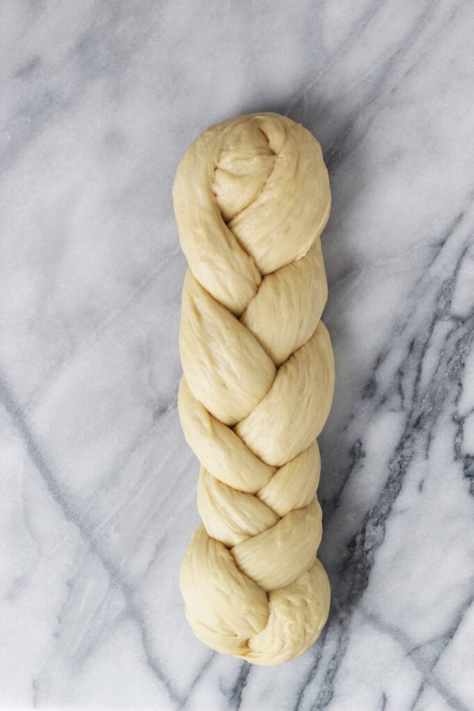 Braided challah bread before being baked