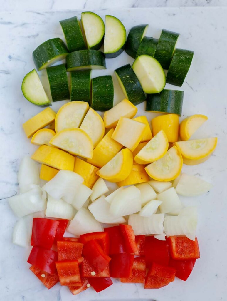 Diced vegetables on a table top.