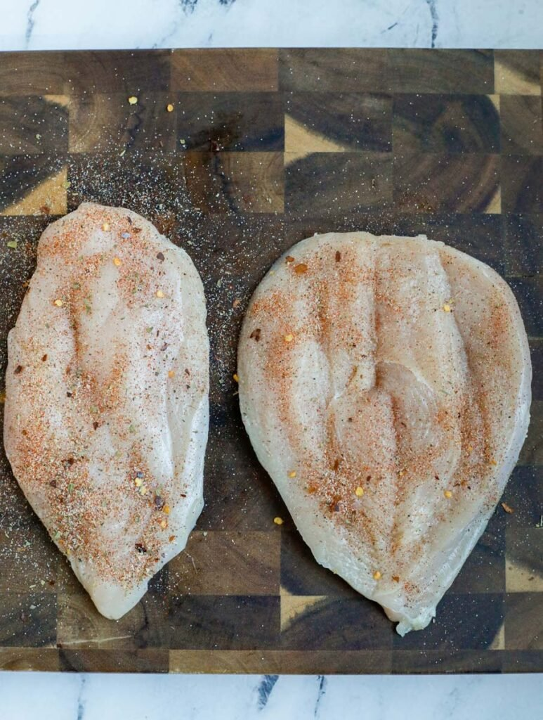 Chicken breast with seasoning.