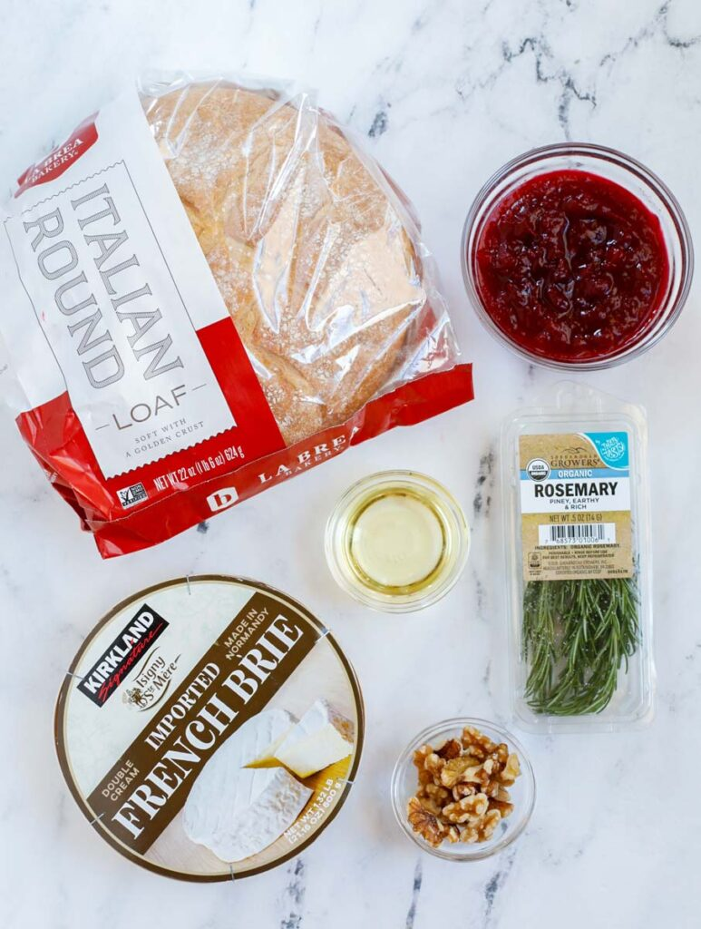 Top down view of ingredients for baked brie bread board.