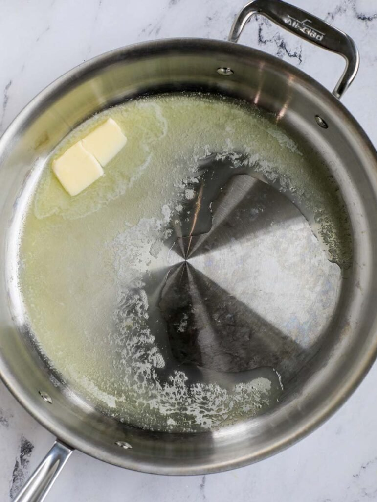 Butter in a pan.