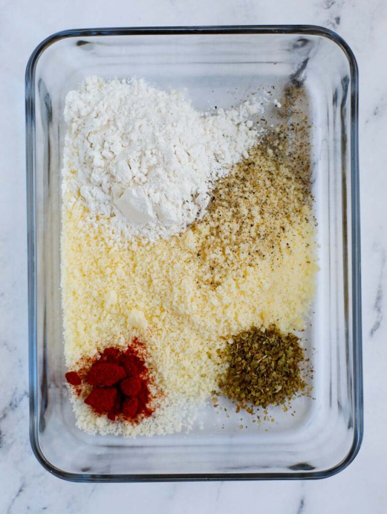 Seasoning and flour in a container.