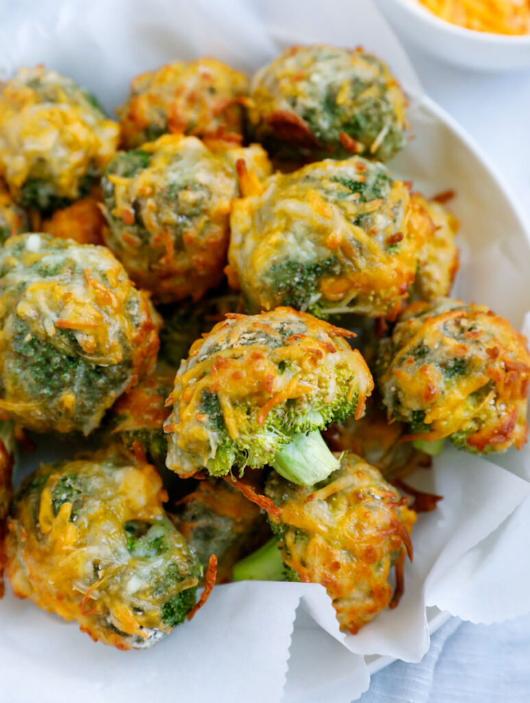 Close up of cheesy broccoli bites in a bowl.