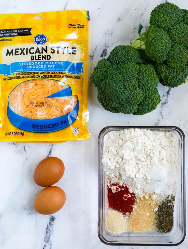 Overhead shot of ingredients for cheesy broccoli bites.