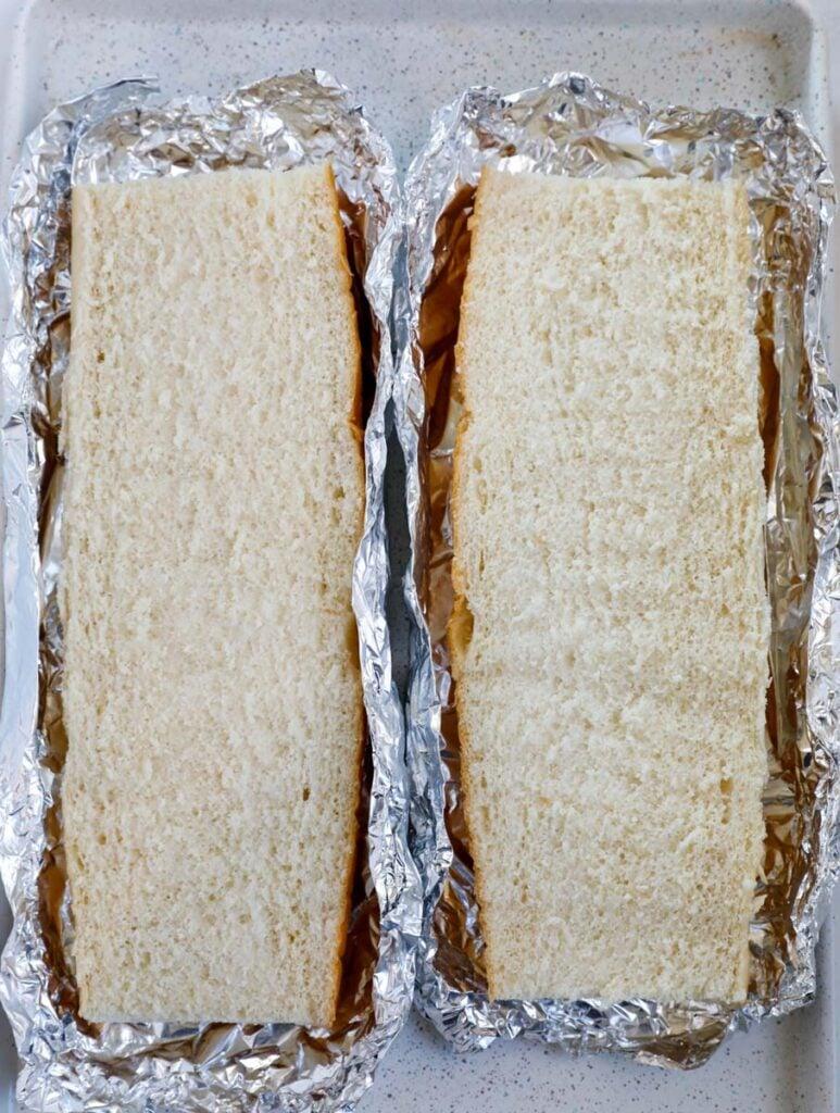 Top down shot of sliced bread in foil.