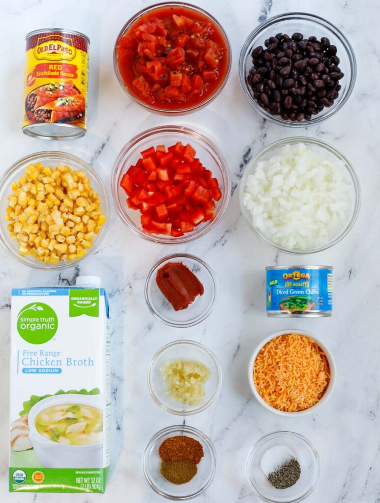 Top down view of ingredients needed to make chicken enchilada soup.