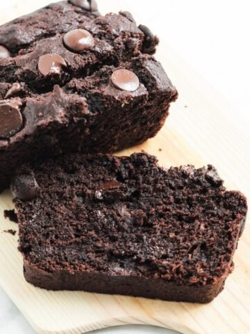 slice of chocolate banana cake on a wooden board