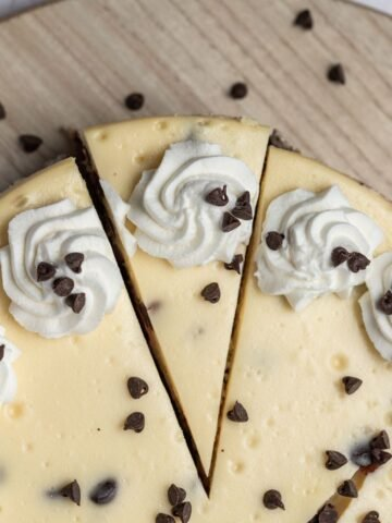 top down view of chocolate chip cheesecake with a slice cut out