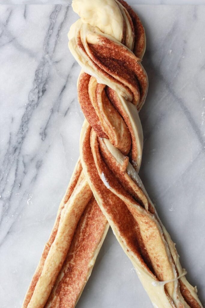 Two strands of dough being twisted.