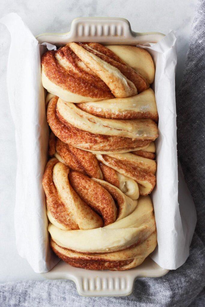 Top down shot of cinnamon babka in a loaf pan.
