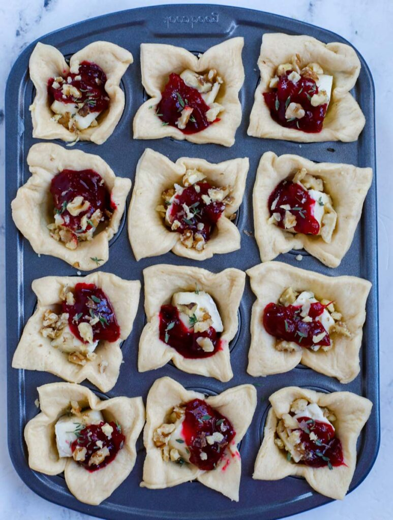 Brie bites with cranberry, before cooking.