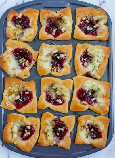 Top down shot of cranberry brie bites in a pan.