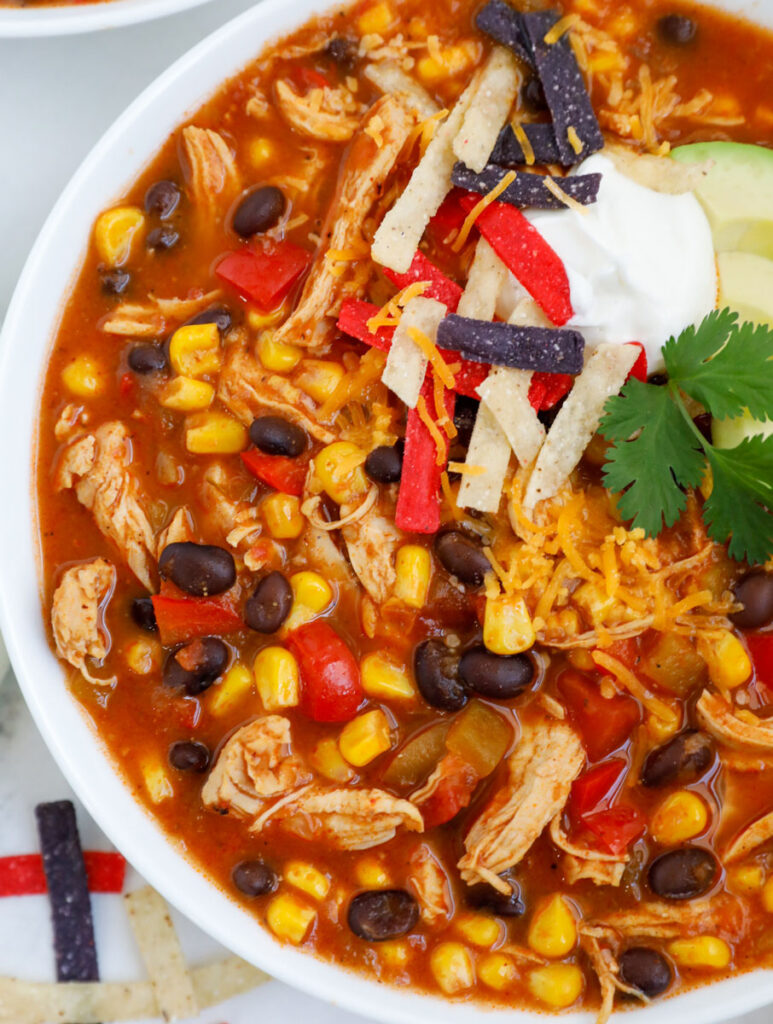 Close up of a bowl of creamy chicken enchilada soup.
