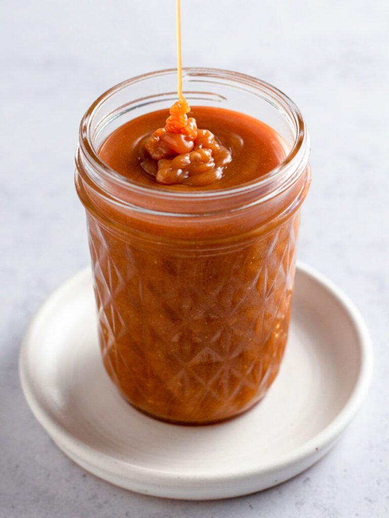 Caramel sauce in a a jar.
