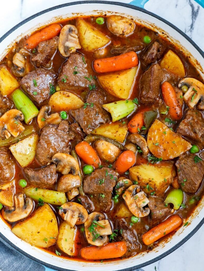 Overhead view of beef stew in a bog pot.