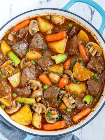 Top down view of best beef stew in a blue pot.