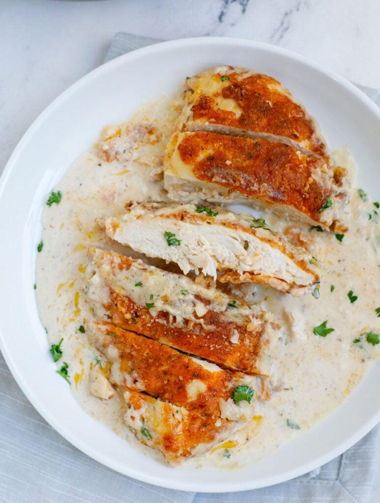 Creamy chicken sliced with Caesar sauce.