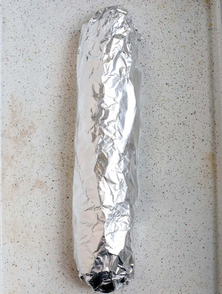 bread wrapped in foil to bake