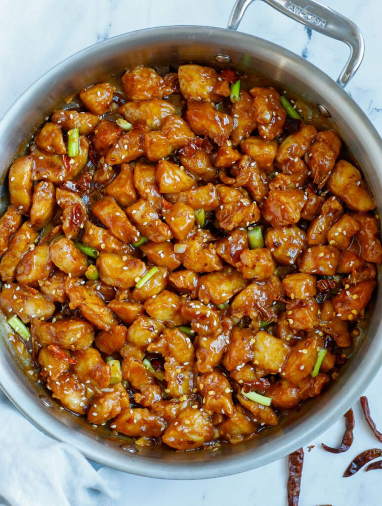 Overhead photo of saucy general tso chicken in a skillet.