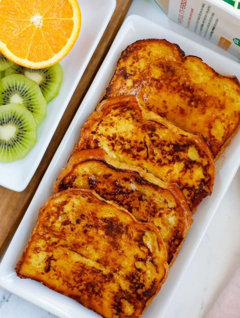 A platter of four orange french toast.