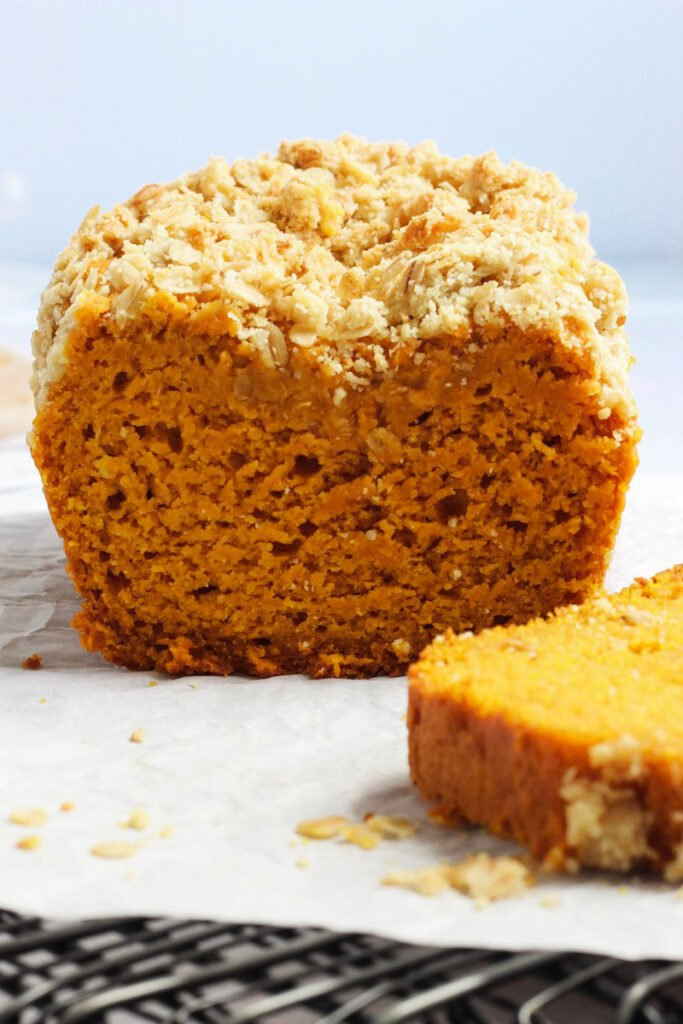 Close up of sliced easy pumpkin bread on a table.