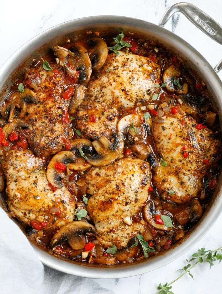Top down shot of tuscan chicken in a skillet.