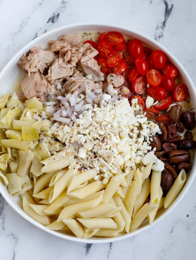Overhead shot of pasta and veggies in a bowl.