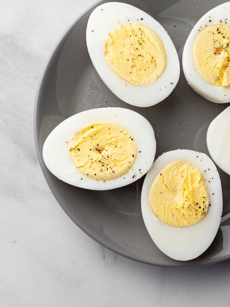 hard boiled eggs cut in half and seasoned with salt and pepper