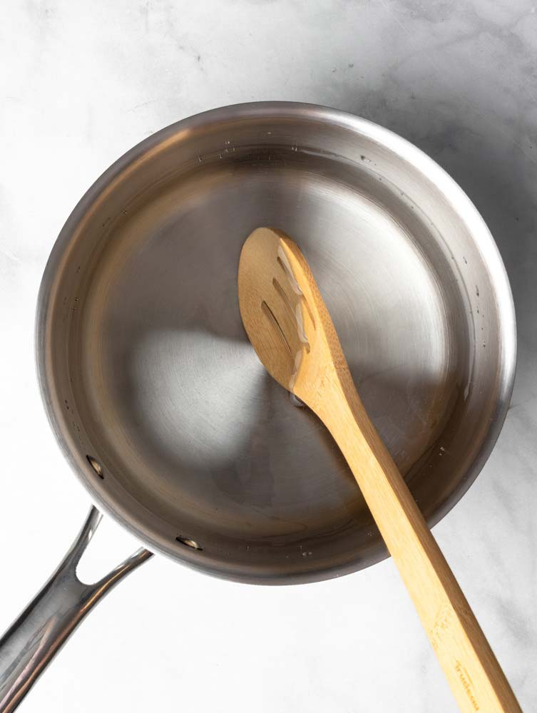hot water in a pot with a spoon