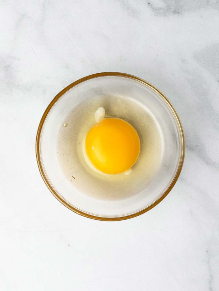 a cracked egg in a bowl