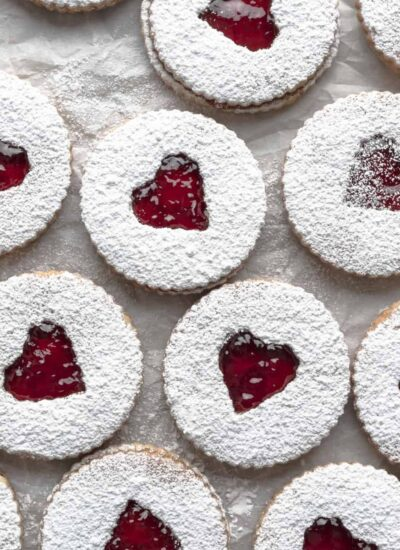 Overhead image of multiple assembled strawberry cookies.