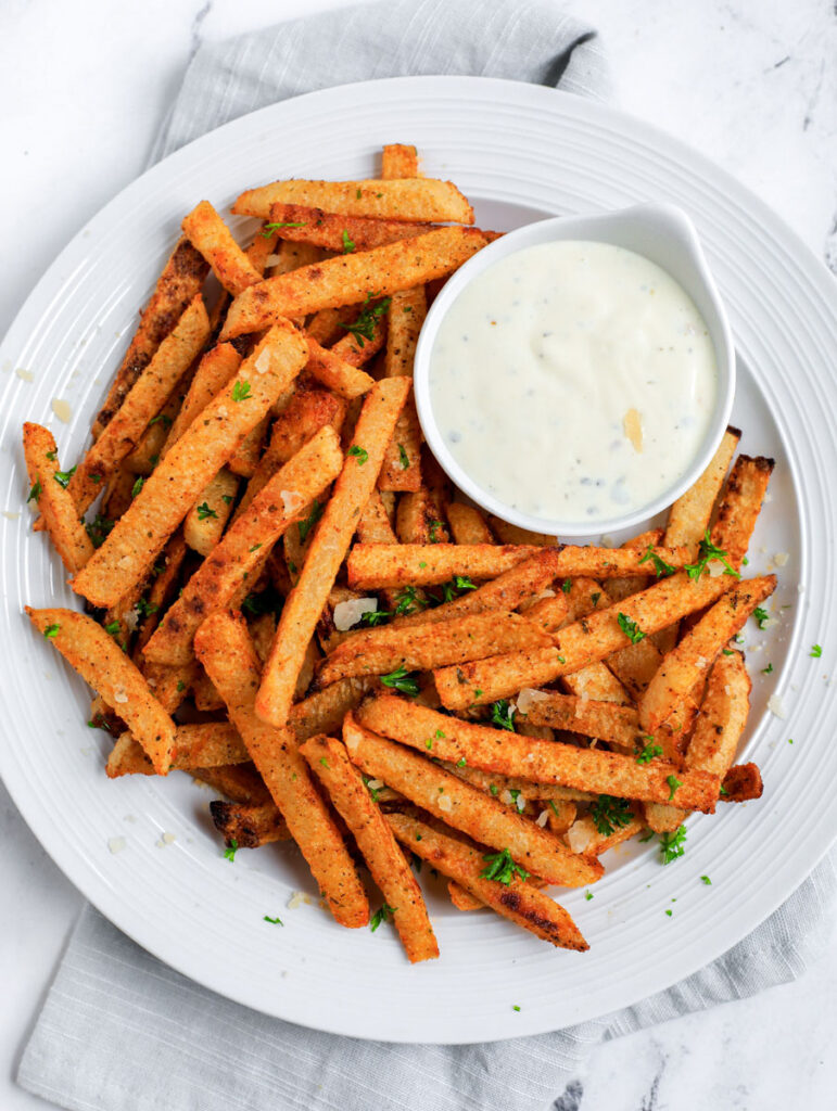 White plate with Jicama Fries and dip.