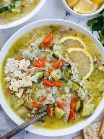 Overhead view of a bowl of lemon chicken rice soup.
