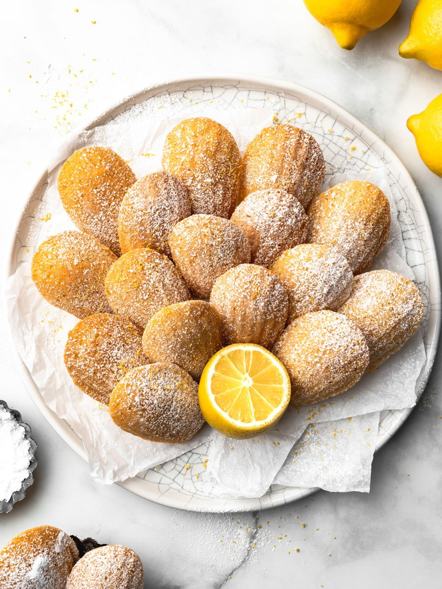 A white plate of lemon madeleines.