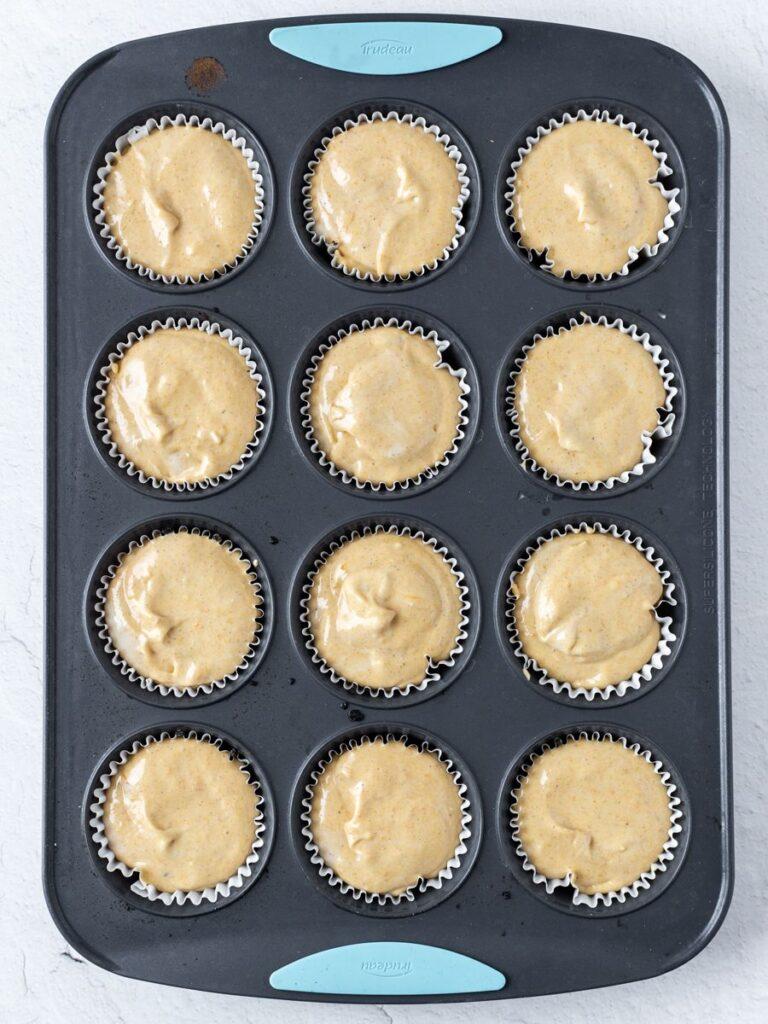 Top down shot of mini pumpkin cheesecakes in a mold.