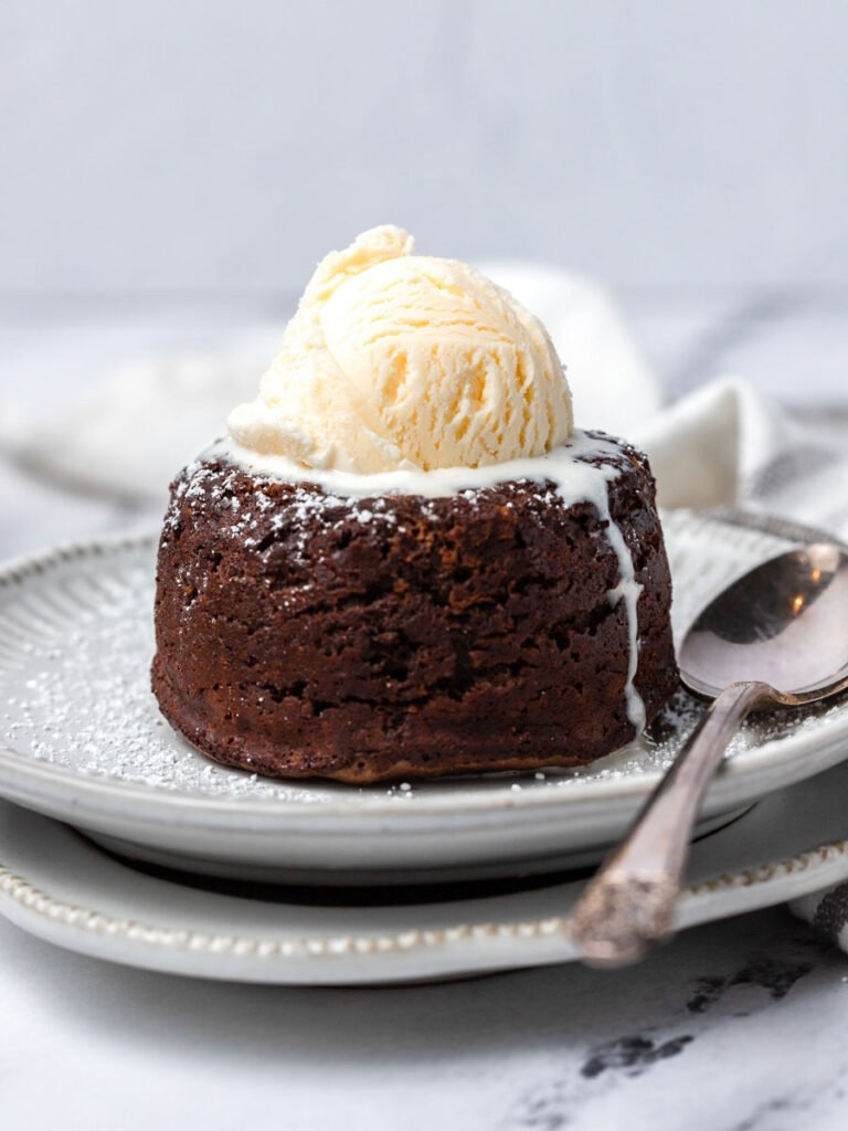 A chocolate molten lava cake with ice cream on top.