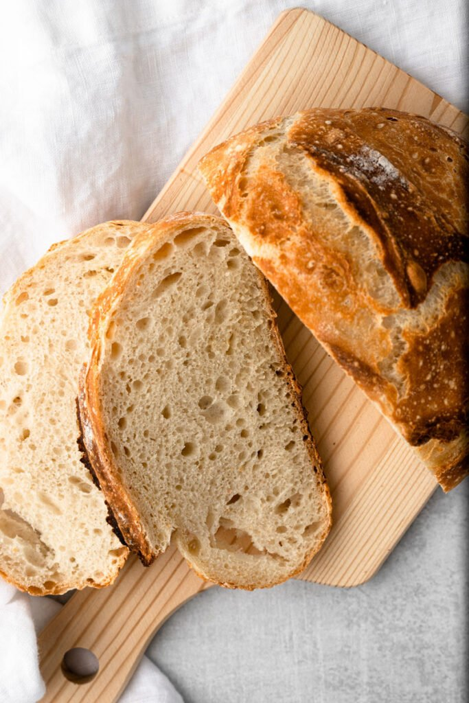 No knead artisan bread sliced opened.
