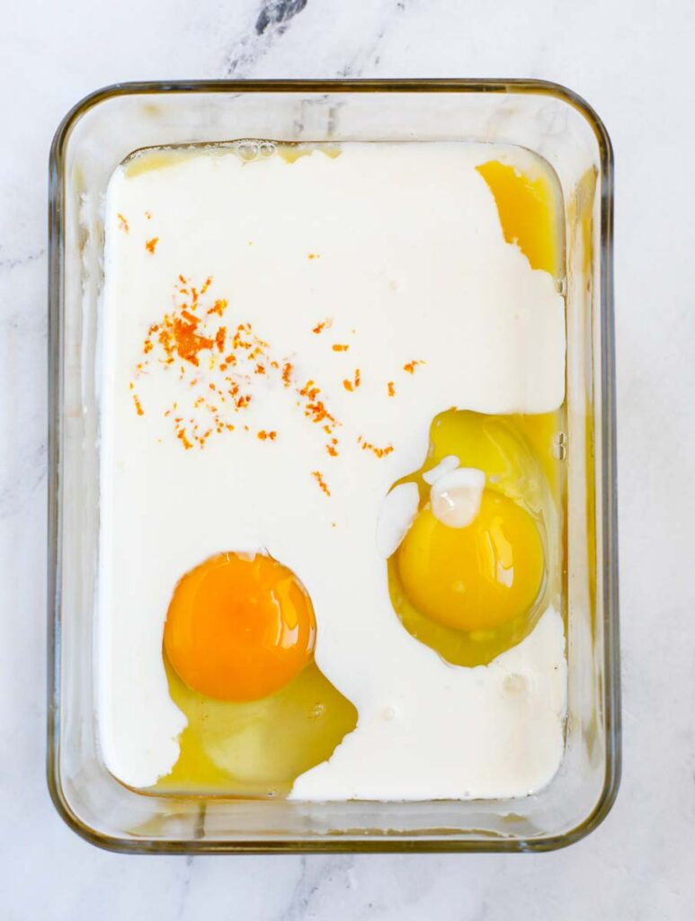 Ingredients for custard added to a container to be mixed.