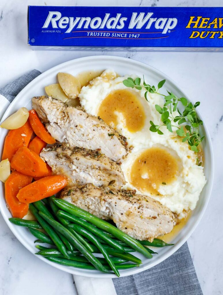 plate of turkey breast with vegetables and mashed potatoes