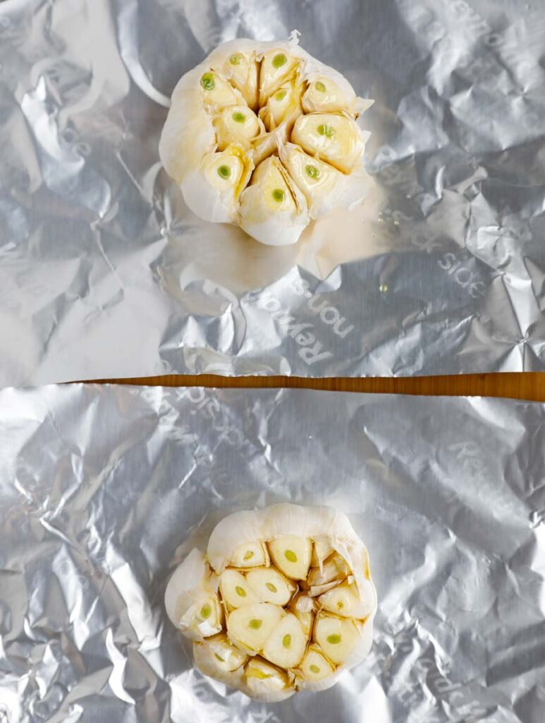 whole garlic, top sliced with drizzle of olive oil