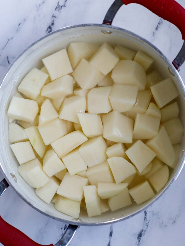 Diced potatoes in a pot.