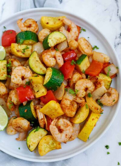 overhead shot of the shrimp and vegetables in a white plate